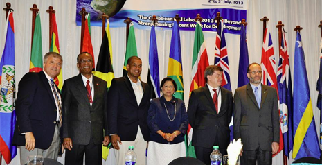 Left to right: Cayman Islands Director of Labour & Pensions Mr. Mario Ebanks; Trinidad & Tobago Minister of Labour and Small & Micro-Enterprise Development Hon. Errol McLeod; Cayman Islands Councillor for Education, Employment & Gender Affairs Mr. Winston Connolly; Prime Minister of the Republic of Trinidad & Tobago Hon. Kamla Persad-Bissessar; Director General of the International Labour Organization His Excellency Guy Ryder; and Secretary General, Caribbean Community Secretariat His Excellency Irwin La Rocque.